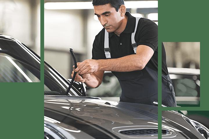 Mechanic working on a MINI vehicle's wiper blades