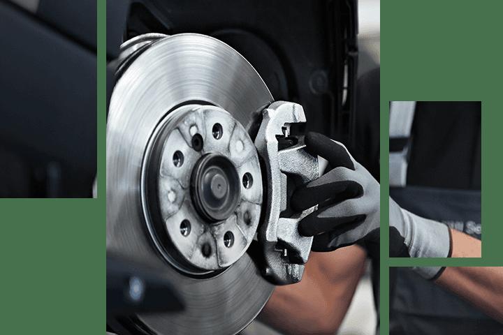 Mechanic working on a MINI vehicle's brake pad