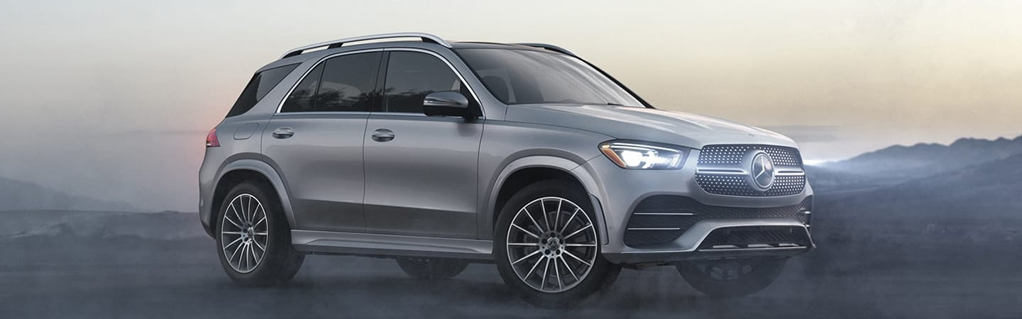 Silver 2020 Mercedes-Benz GLE with headlights on