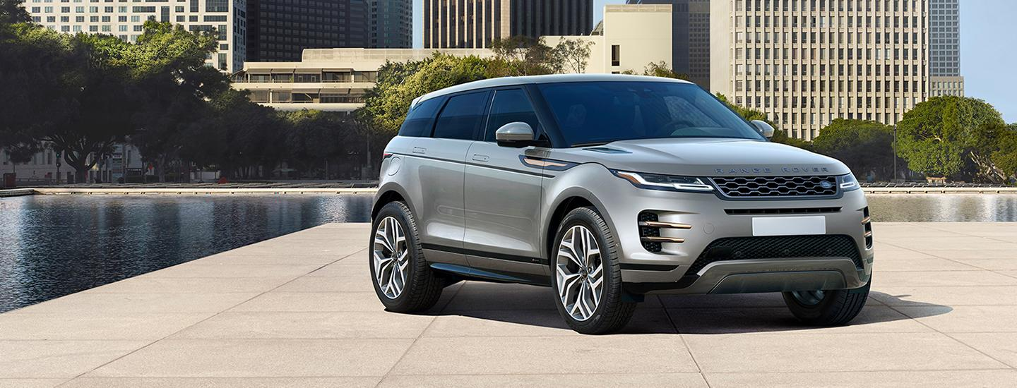 Side view of the 2020 Land Rover Range Rover Evoque parked inside a courtyard
