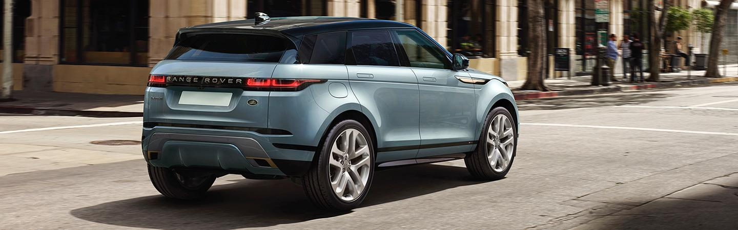 Rear view of the 2020 land Rover Range Rover Evoque driving down the road