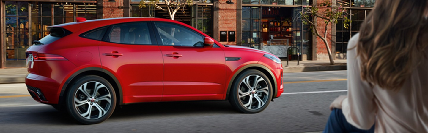 Side view of the 2020 Jaguar E-Pace and the side of the street