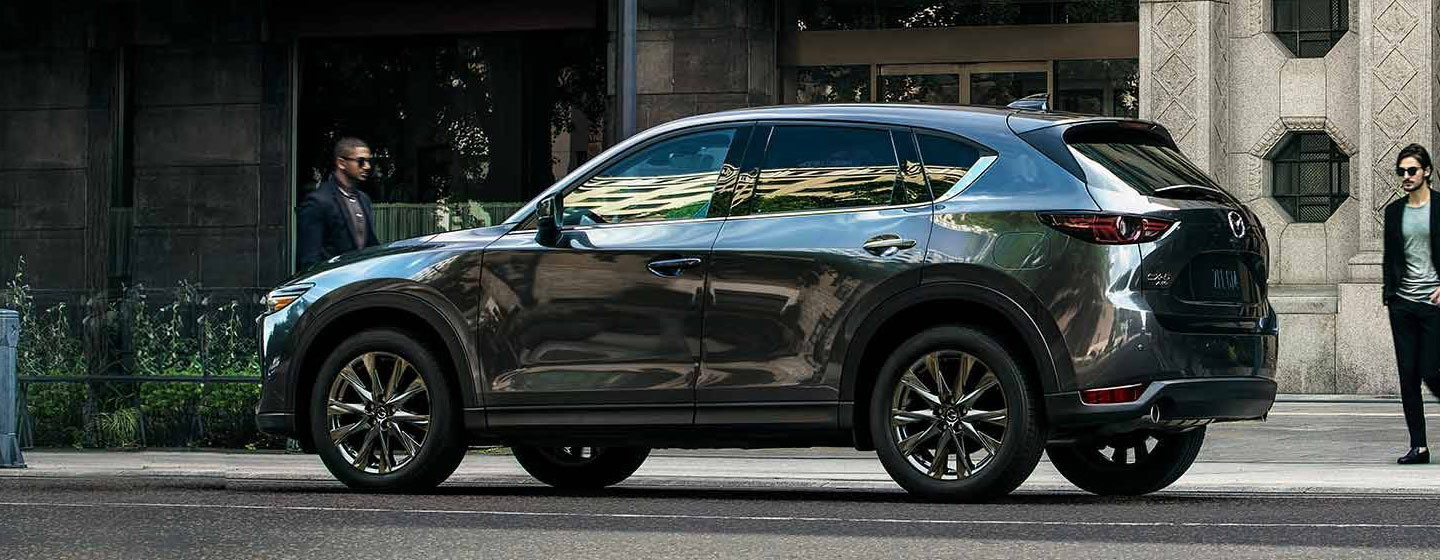2019 Mazda CX-5 driver side view parked in city.