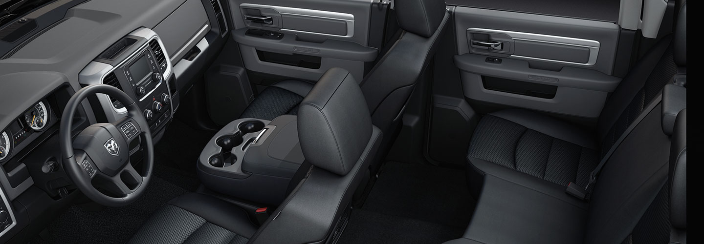 Overhead view of the 2021 RAM 1500 front and rear seats, steering wheel, and infotainment system
