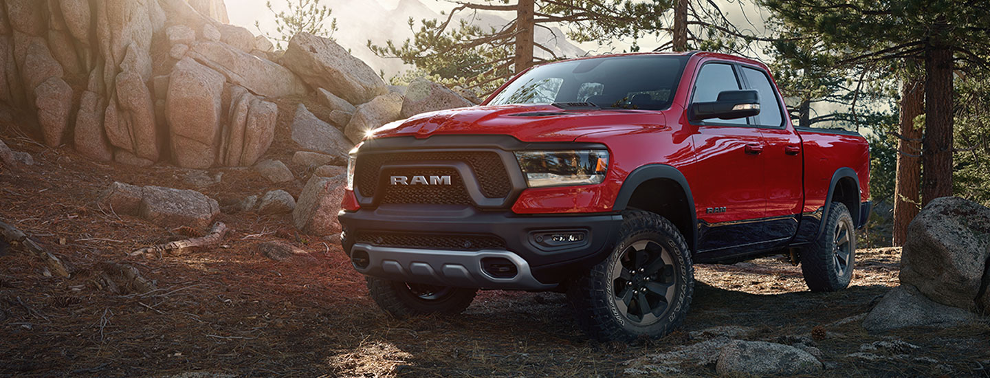Front view of a red 2021 RAM 1500 in the woods