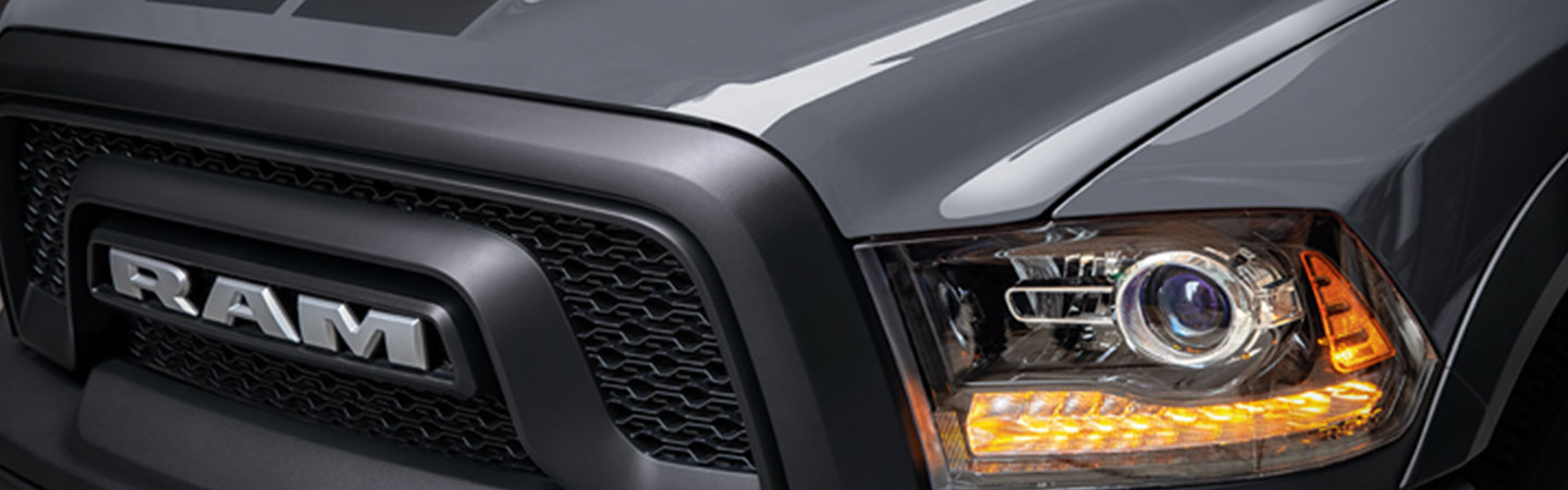 Close-up of a 2021 RAM 1500 grille and headlight