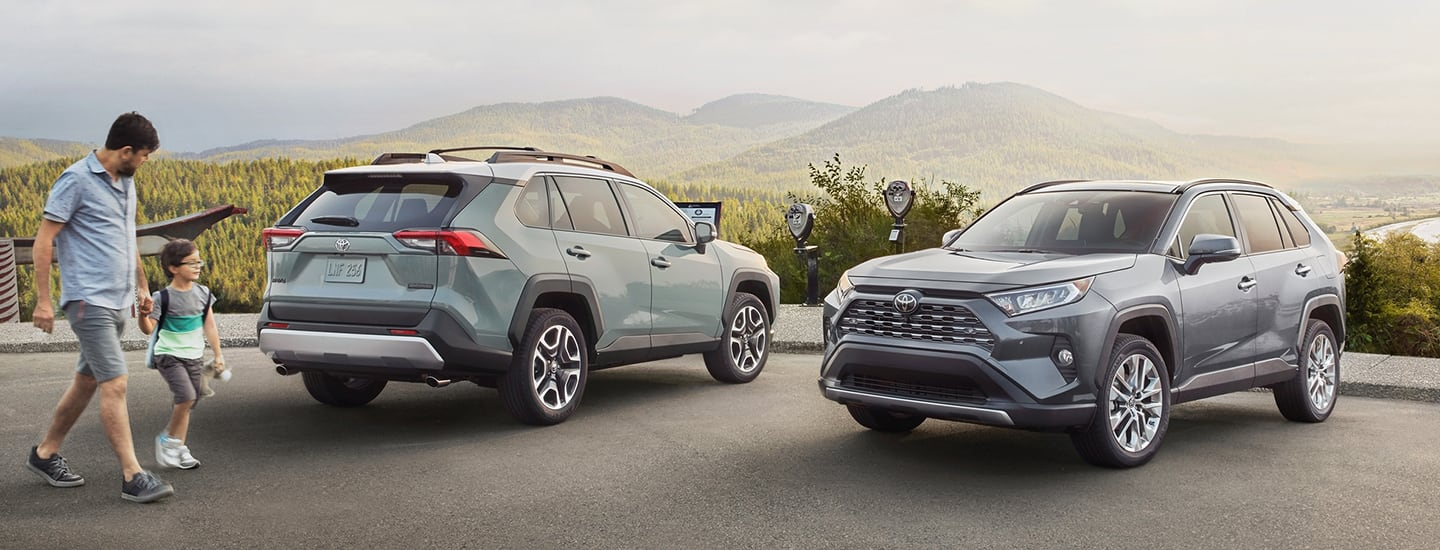Two 2020 Toyota RAV4 vehicles parked in a parking lot