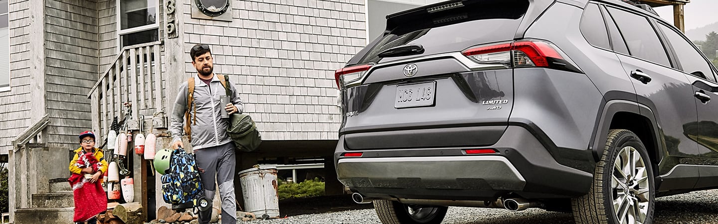 2020 Toyota RAV4 parked outside of a house with family approaching