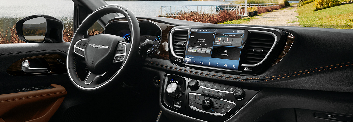 Close-up of the 2021 Chrysler Pacifica steering wheel and infotainment system
