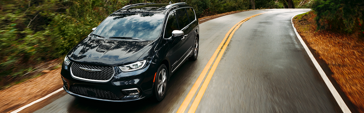 Top view of a black 2021 Chrysler Pacifica driving down the road