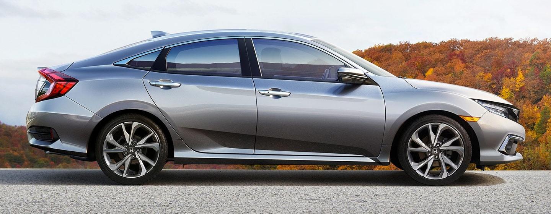 2019 Honda Civic parked passenger side view.