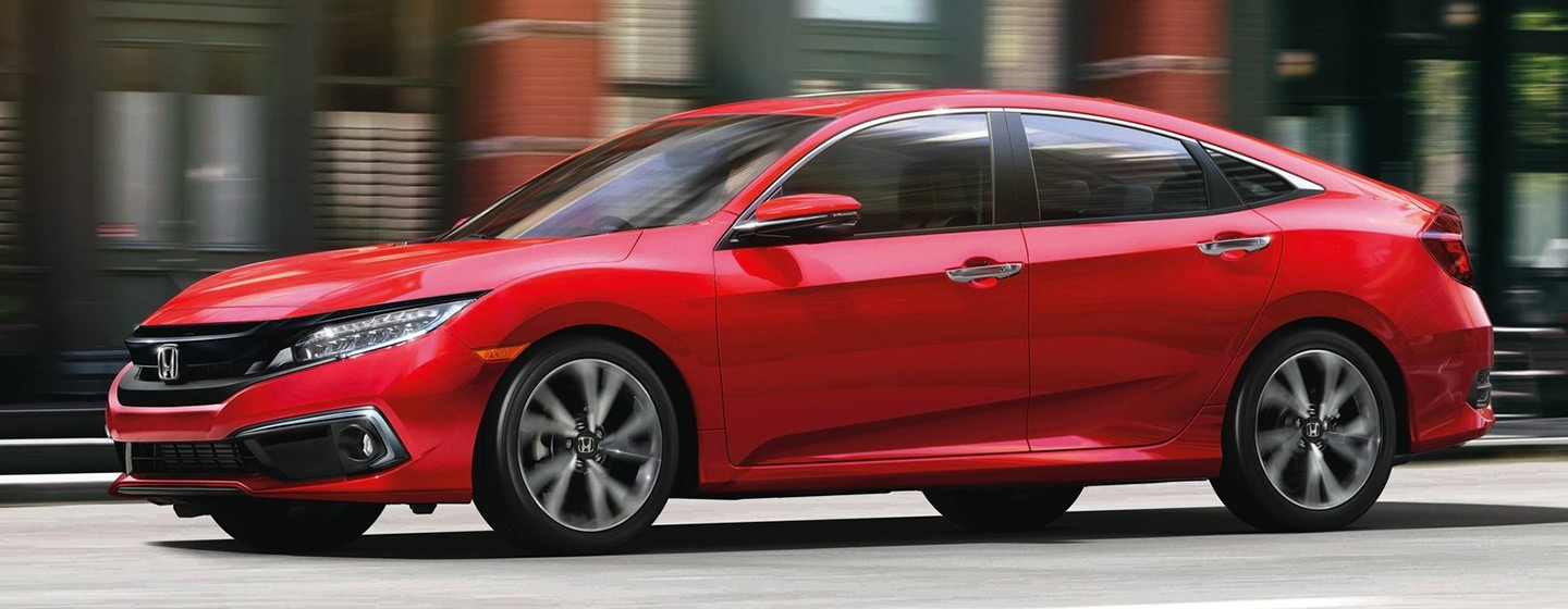 2019 Honda Civic in motion driver side view.
