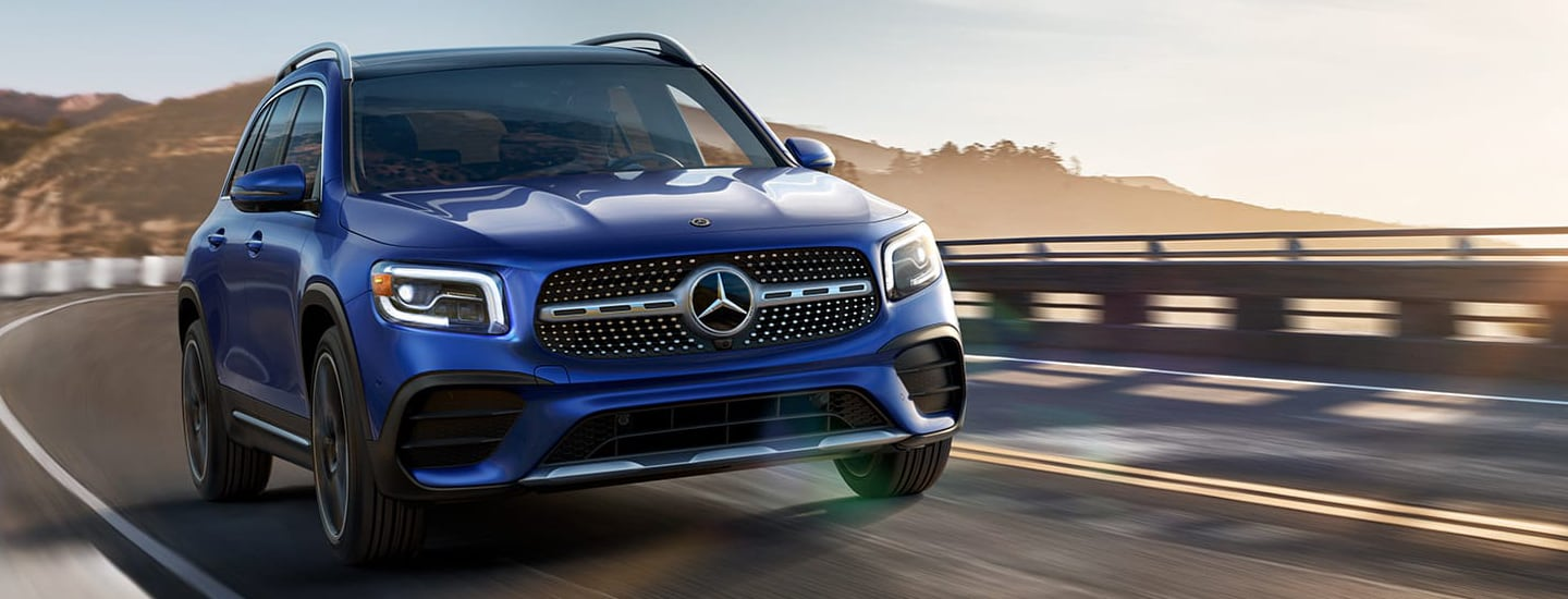 Front view of a blue 2020 Mercedes-Benz GLB driving on the highway