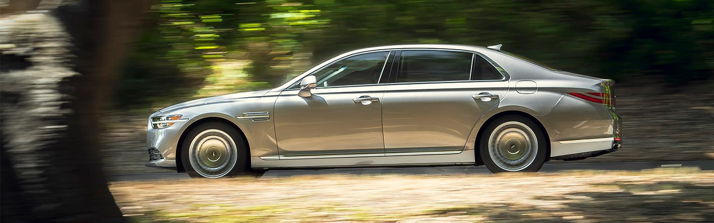 Silver 2021 Genesis G90 in motion side angle