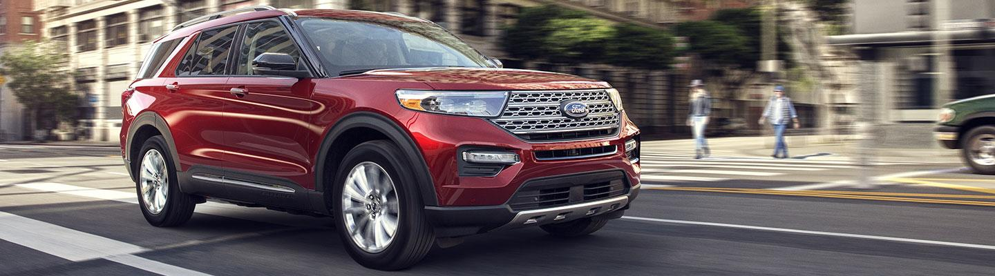 Red Ford Explorer in motion through the city