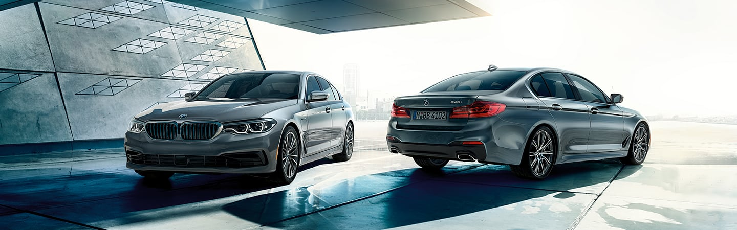 Two 2020 BMW 5 Series models parked next to each other