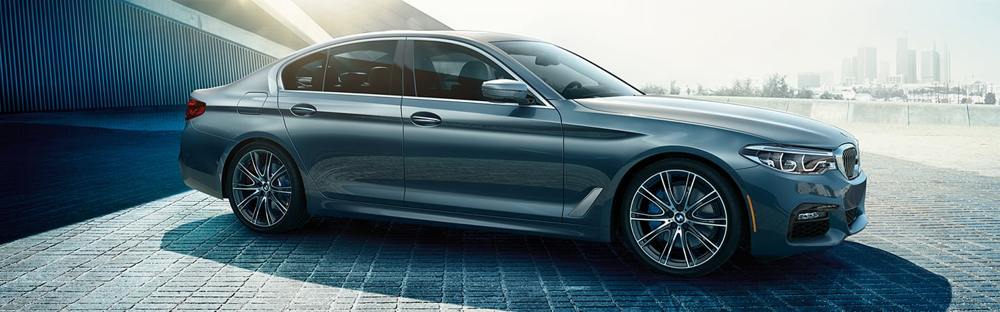 Side view of the 2020 BMW 5 Series parked