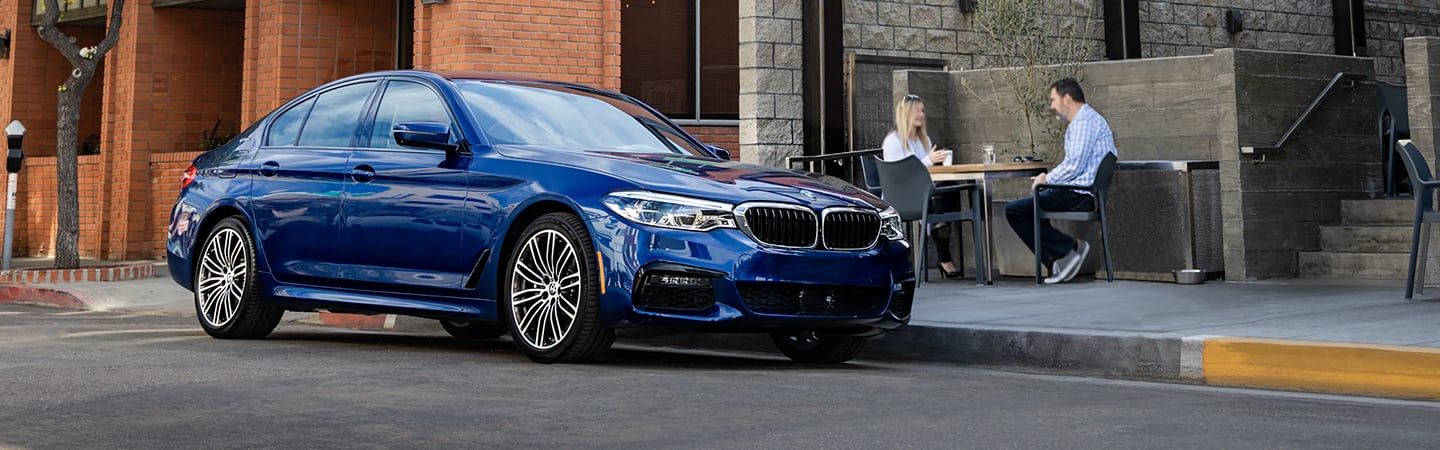 2020 BMW 5 Series parked on a city street