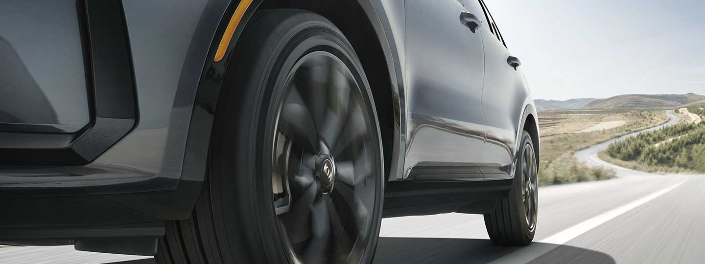 Low profile view of a Kia Sorento's tires in motion