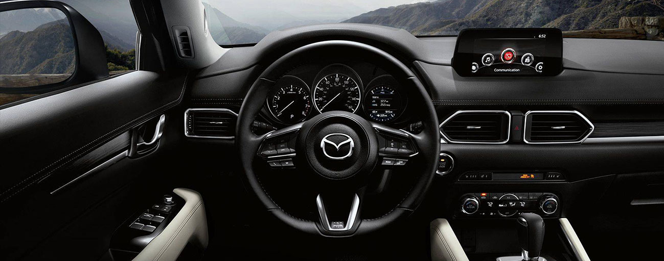Safety features and interior of the 2018 Mazda CX-5 - available at our Mazda dealership in Laurel, MD.