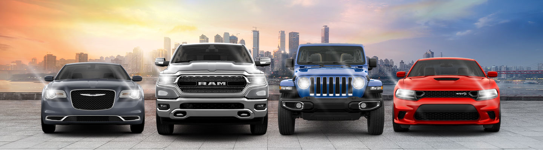 4 Car lineup Chrysler Ram Jeep with City Skyline at sunset