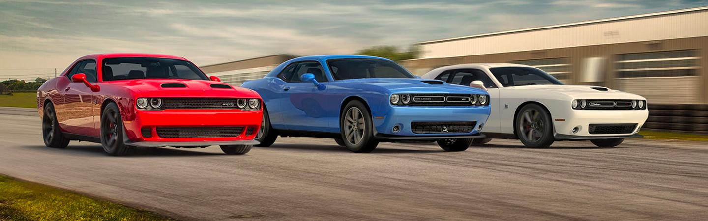 Three 2020 Dodge Challenger models side by side in motion