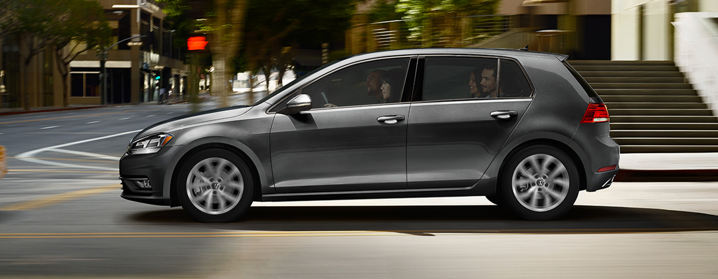 2019 VW Golf Exterior - Side View - Driving through an intersection.