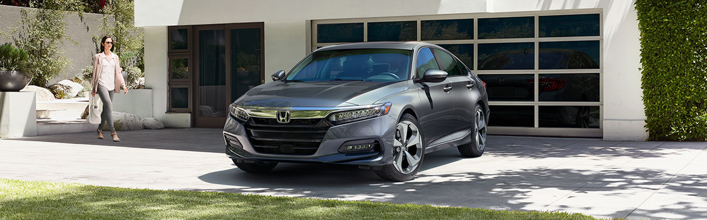 2019 Honda Accord grey parked in front of modern home