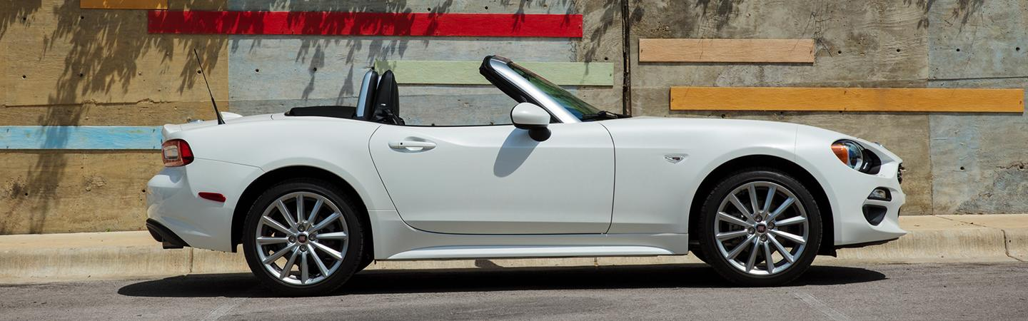 Side view of a white 2020 FIAT 124 Spider parked