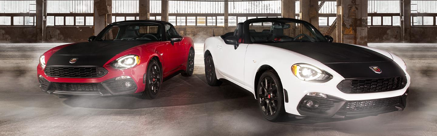 Red and white 2020 FIAT 124 Spider models parked