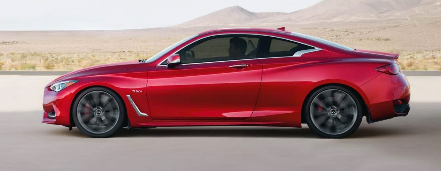 2019 INFINITI Q60 Exterior - Side View - Driving on the road.