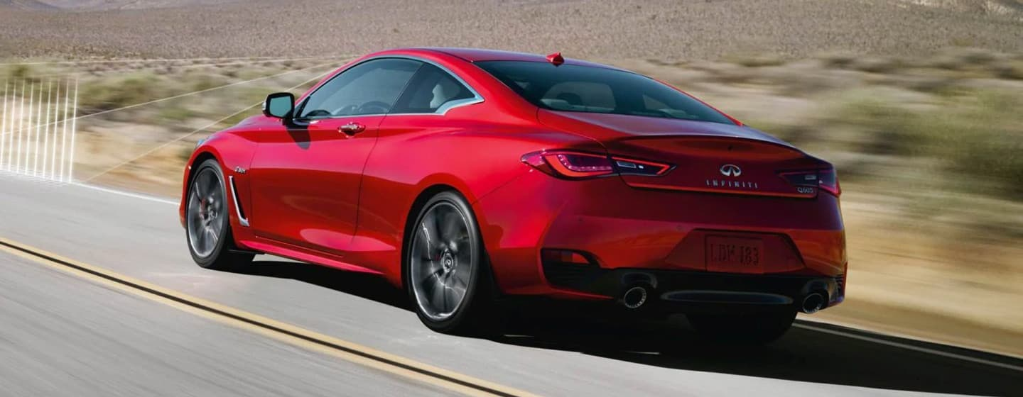 2019 INFINITI Q60 Exterior - Rear View - Driving on the road.