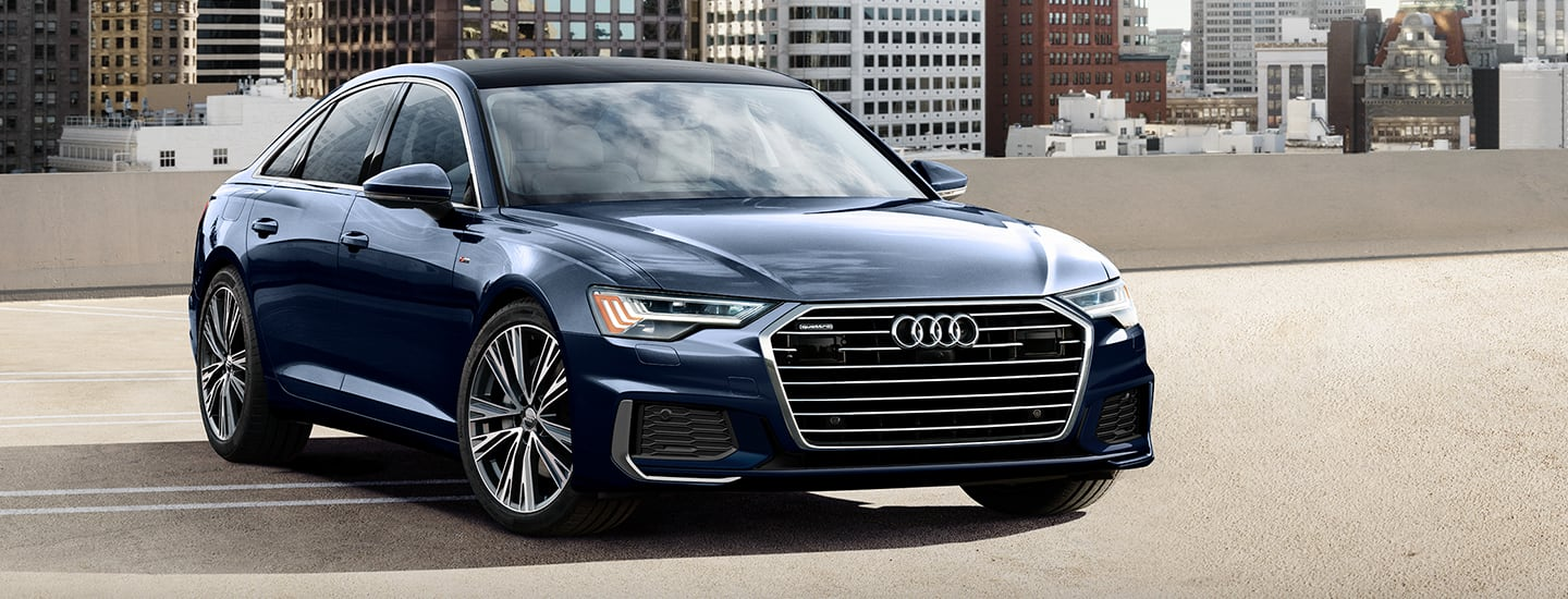 Front view of blue 2020 Audi A6 parked