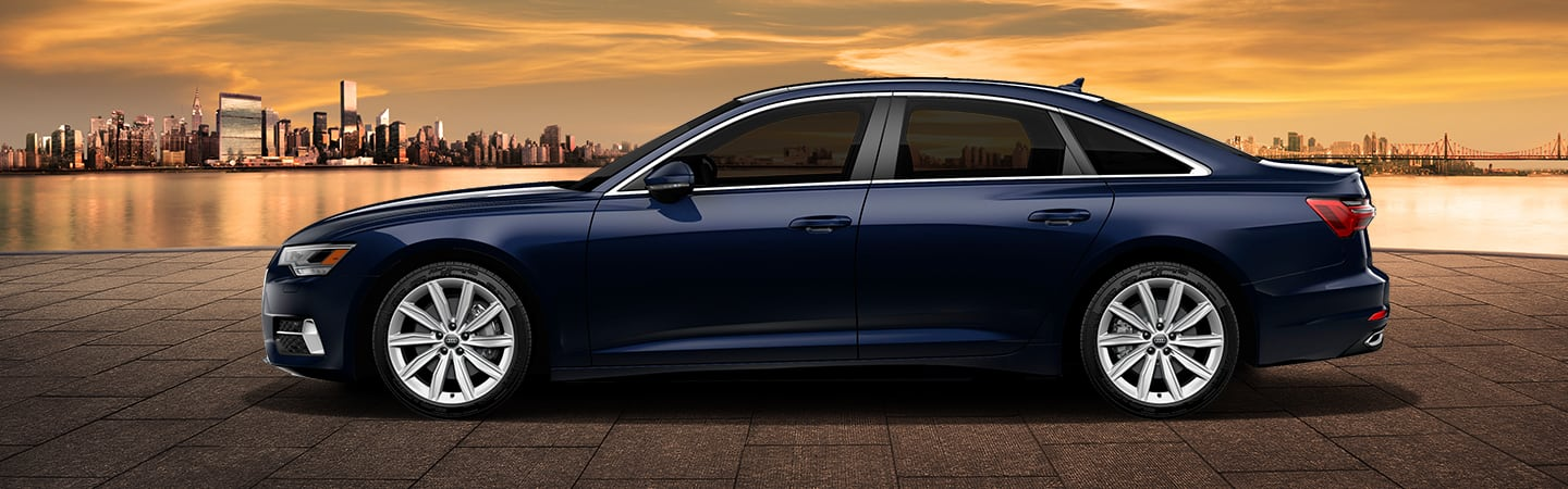 Side view of blue 2020 Audi A6 overlooking the city