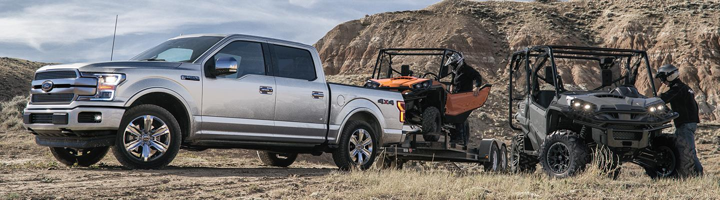 2019 Ford F-150 towing an all-terrain vehicle