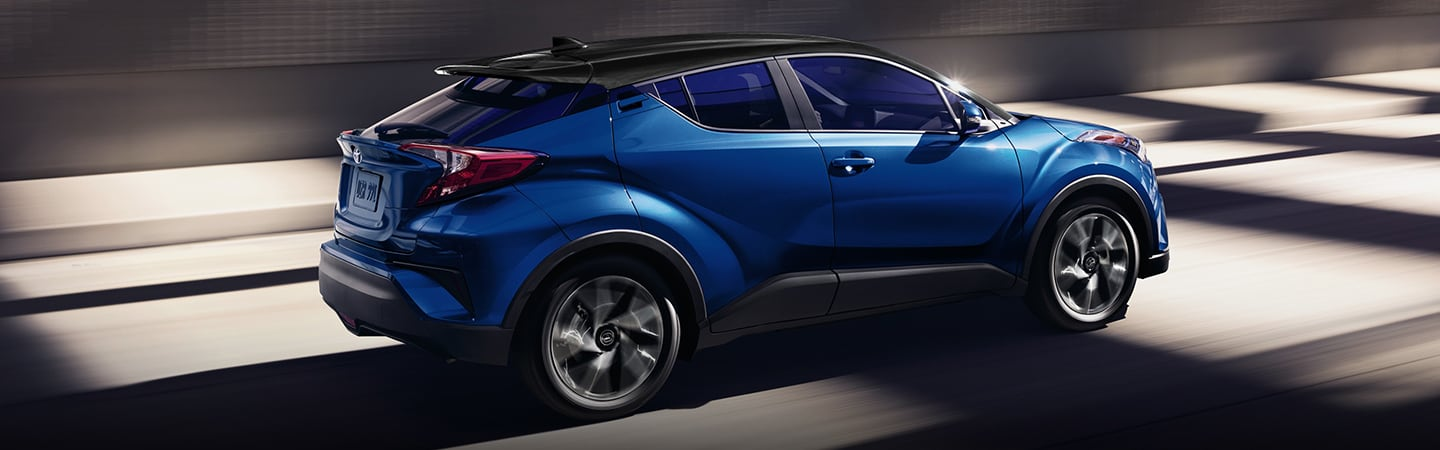 Blue 2020 Toyota C-HR in motion
