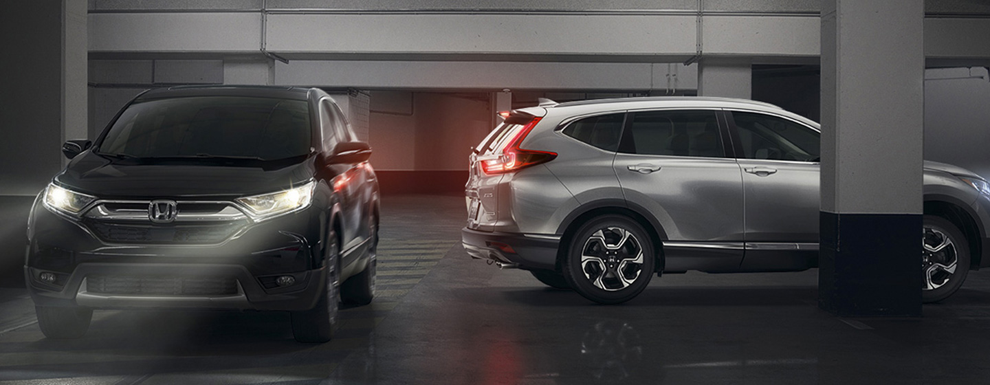 Pair of 2019 Honda CR-V SUVs - Parked in a parking garage