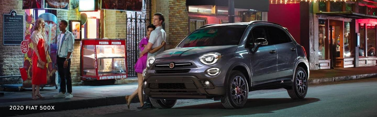 2020 FIAT 500X parked in the city with people walking nearby