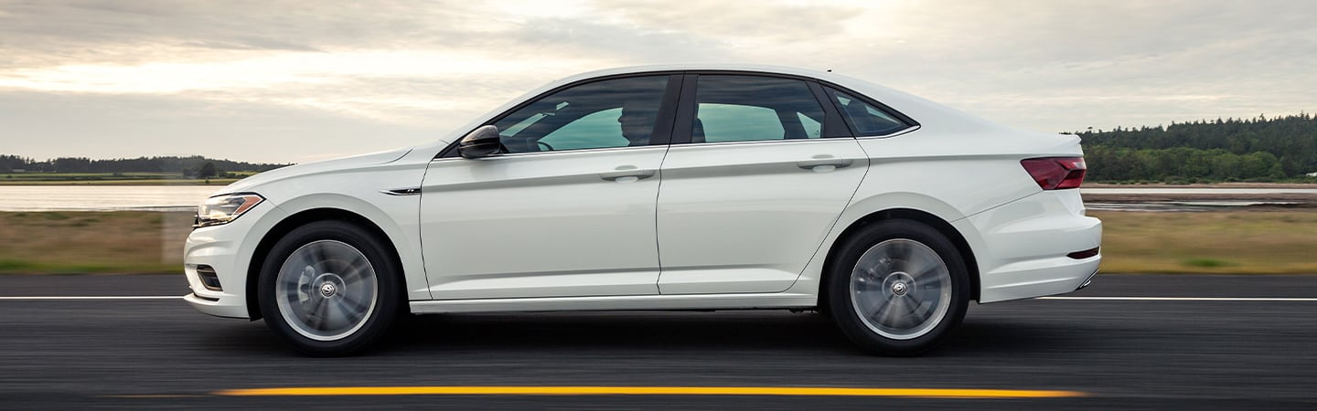 Side view of the left side of the 2020 Volkswagen Jetta in motion