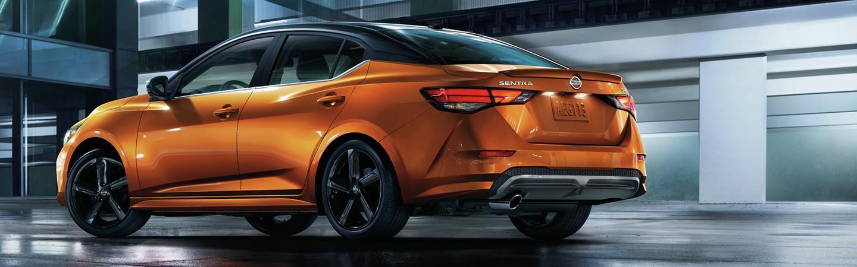 Parked Monarch Orange 2021 Nissan Sentra