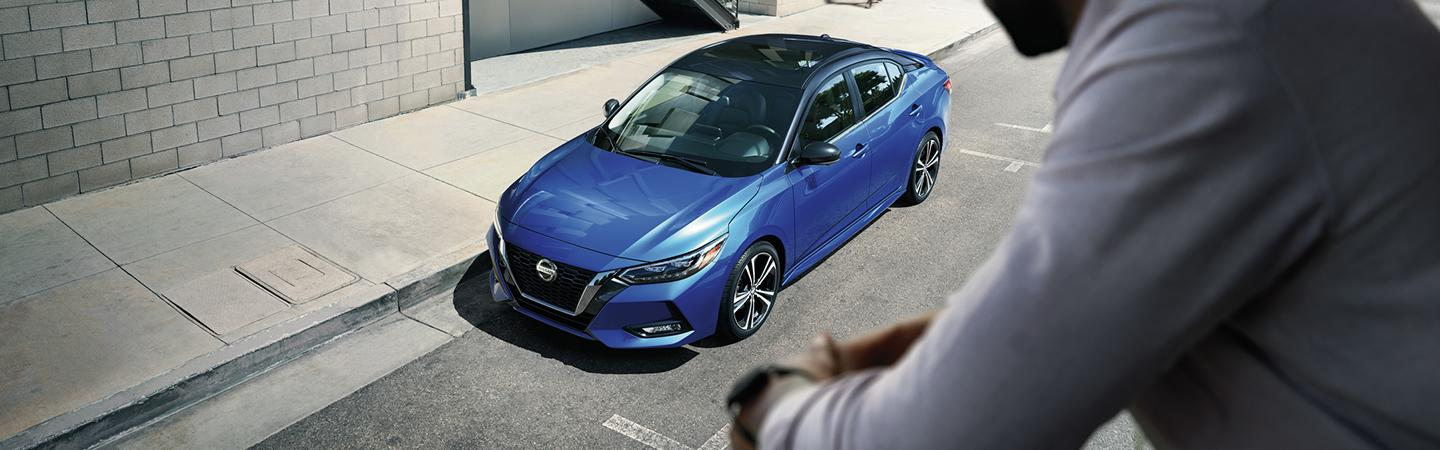 2021 Nissan Two-Tone Electric Blue Metallic Super Black Sentra parked outside