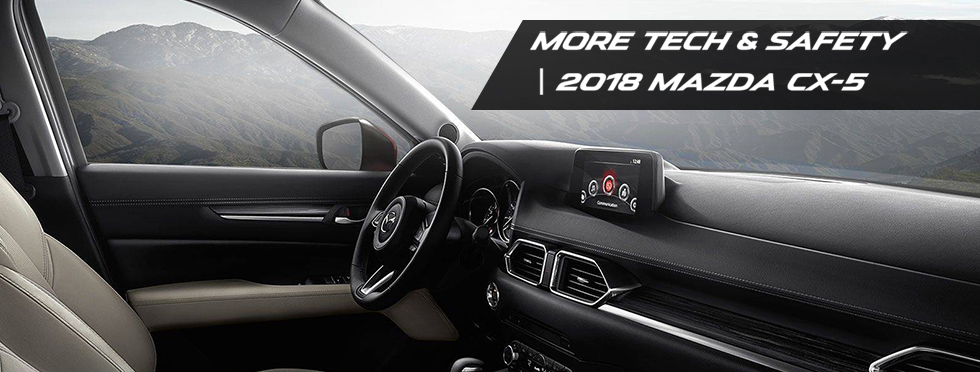 Safety Features and interior of the 2018 Mazda CX-5 in Louisville, KY - available at Neil Huffman Mazda