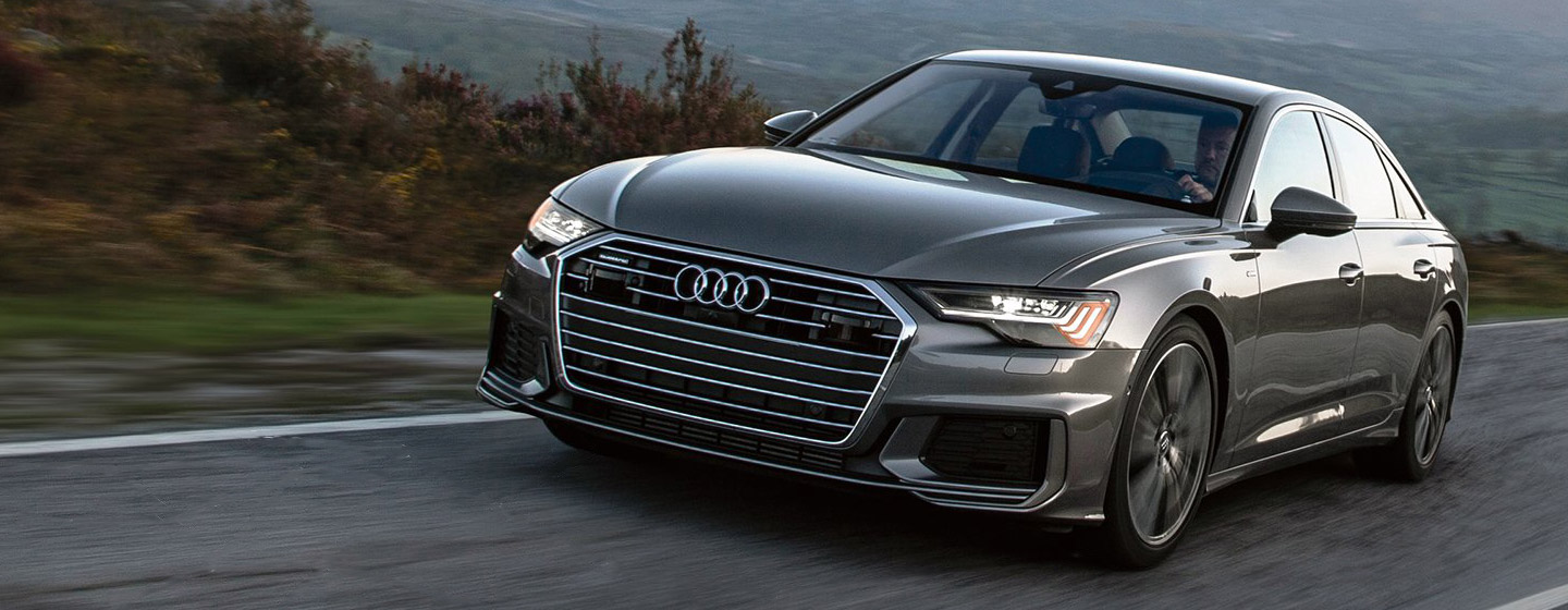 2019 Audi A6 front view driving.