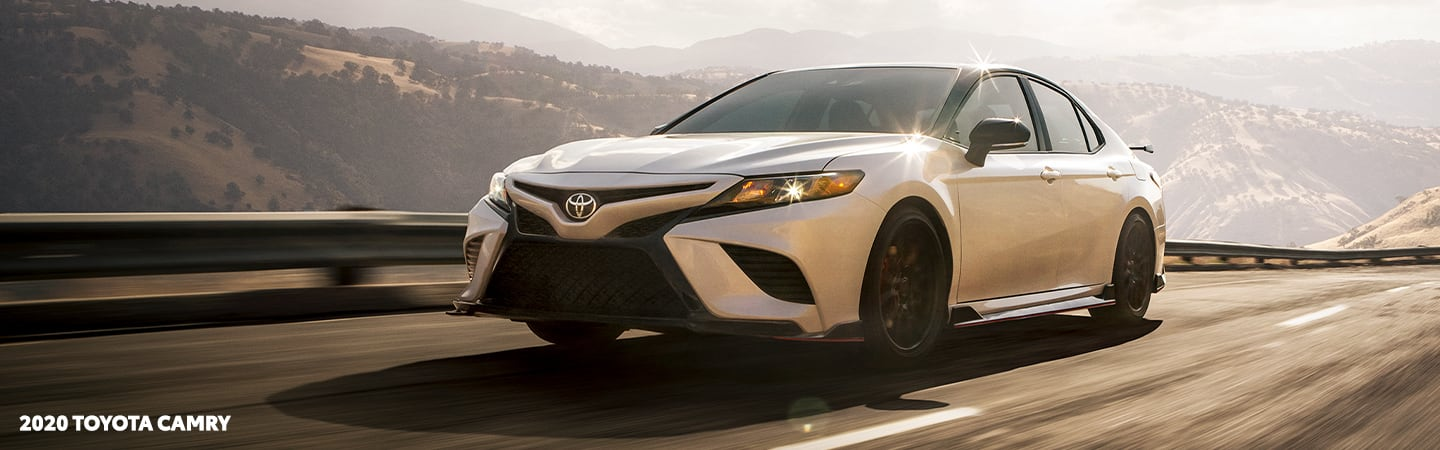 White 2020 Toyota Camry in motion