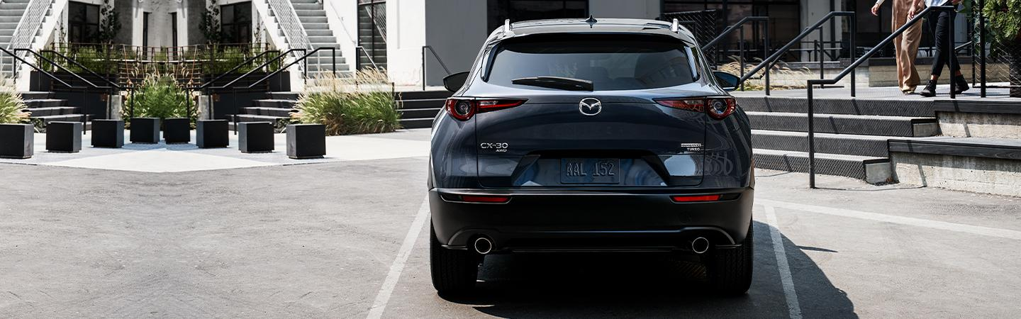 Rear view of the 2021 Mazda CX-30 parked in a parking space