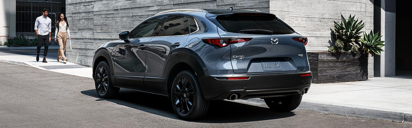 A couple walking up to the 2021 CX-30