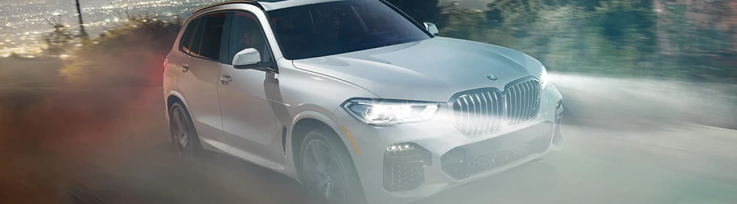 2019 BMW X5 Exterior - Front End - Driving on a dirt road