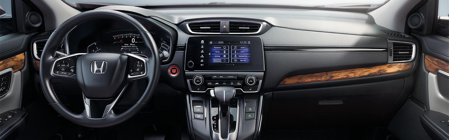 Drivers perspective of the steering wheel inside the 2020 Honda CR-V