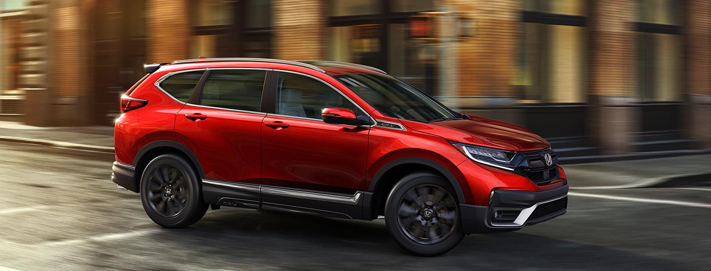 Side view of a red 2020 Honda CR-V in motion