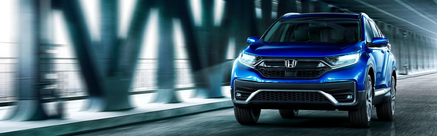 Front view of a blue Honda CR-V in motion